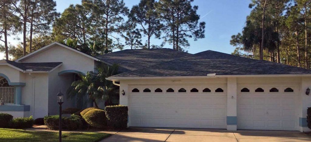 new roof on a white stucco home with blue trim in central Florida